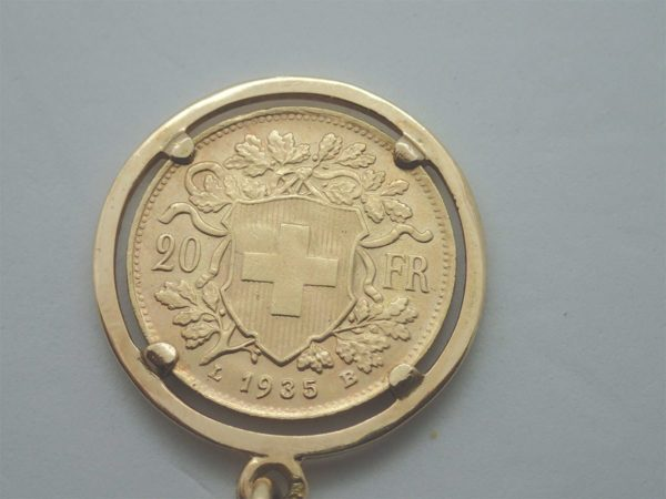 Porte clef en or jaune porte pièce ( 20 francs suisse ) or jaune