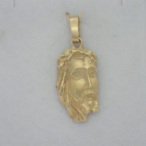Pendentif d' occasion visage christ or jaune 18k 750/000