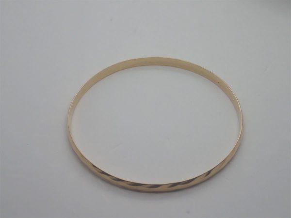 Bracelet jonc d' occasion en or jaune 18k, 750/000