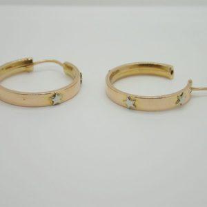 Boucles d' oreilles créoles motifs etoiles d'occasion en or bicolore 18k