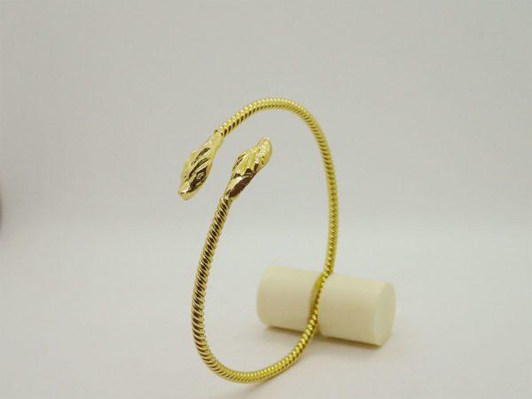 Bracelet jonc torsadé ouvert tete de serpent d'occasion en or jaune 18k