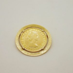 Broche porte piece en or jaune 18k