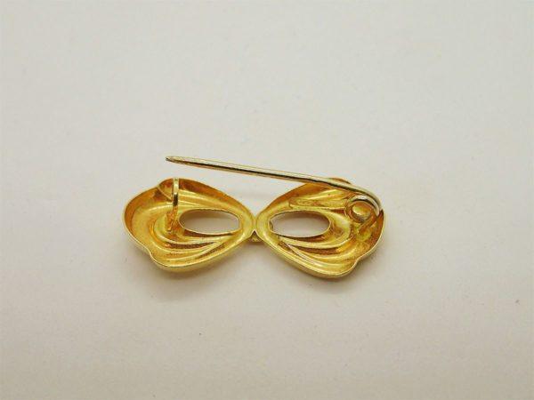 Broche d' occasion en or jaune 18k 750/000