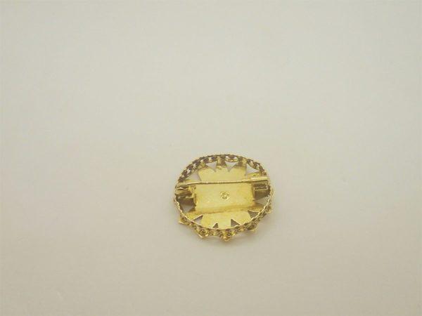 Broche vintage d' occasion en or jaune 18k 750/000 d'un diametre de 25 mm