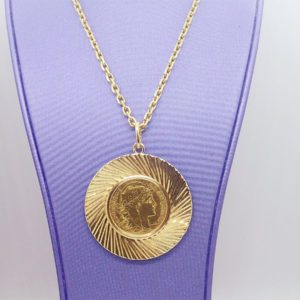 Chaîne avec medaille 20fr marianne de diametre 37mm en or jaune 18k