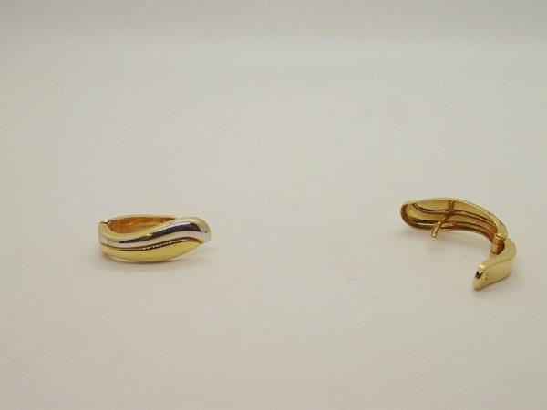 Boucles d'oreilles système clip d'occasion en or bicolore 18k, 750/000