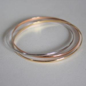 Bracelet rigide 3 anneaux 3 ors 18k- 750 - 11.85grs